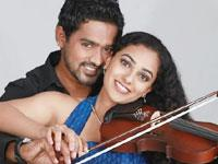 Asif Ali and Nithya Menon in Violin
