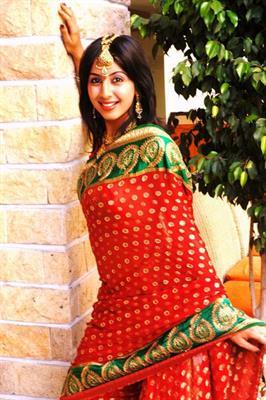 Glamour Raja: Sanjjana in Suresh Gopis action packed movie
